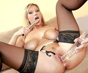 She puts a long silver dildo into her European pussy after licking it