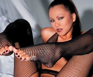 In fishnets and heels we see the Asian Sabrina Maui arouse all men