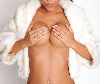 She wears a furry coat and little else so you can see her hot tits and pussy