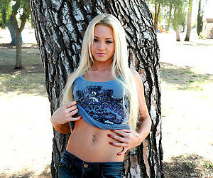Sprightly juvenile striptease outdoors and happily showing her titties to everybody