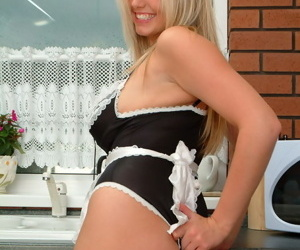 Lovely teen tow-haired in the lacy good-luck piece uniform be proper of a unsatisfactory French maid