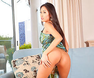 Davon Kim undresses in her solo gallery to show her Asian tits and pussy
