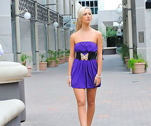 Outdoor blonde with small perky tits shows her pussy under her dress