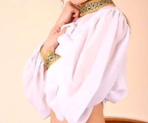 Hot teen wholesale taking off baggy national vestment and demonstrating body