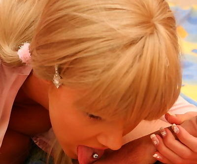 Pigtailed blonde cuttie giving hell of blowjob