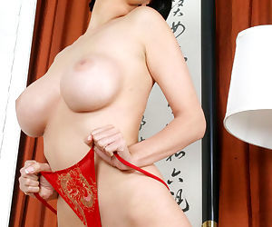 Tera Patrick teases Asian style and finds a big dildo to fuck her pussy