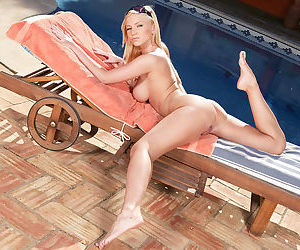 Incredible blonde with hot pink pussy shows off at the pool