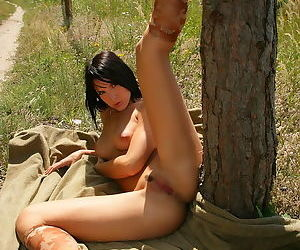 Young chick does outdoor nudity and has a great pussy she can show off