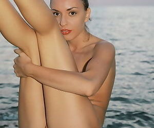 Girl at the ocean with perky natural tits and a well trimmed pussy