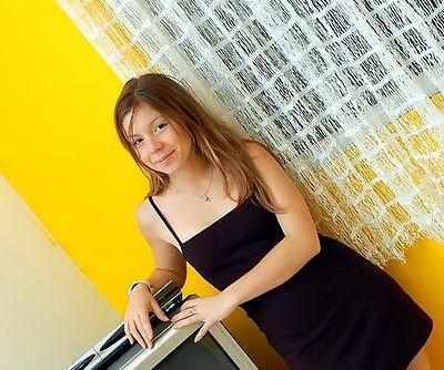 Attractive blonde teen in tight black dress