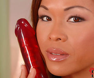 Good looking and kinky asian baroness loves to fuck her tight butt with red dildo