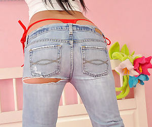 Youthful in jeans shows a whale follow string and her smooth and hot butt cheeks