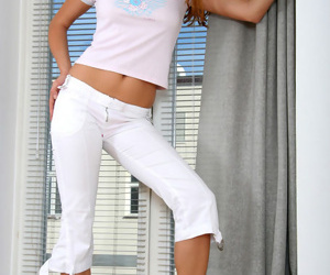 Pretty and hot amateur example posing in rigid white jeans