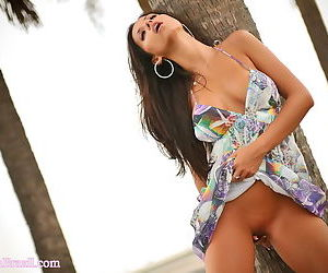 She pulls up her dress outdoors and shows her shaved tight pussy