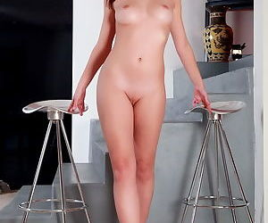 Nude young brunette is a beauty and shows it all including shaved pussy