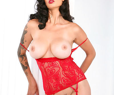 Red lace lingerie and sexy red stockings on tattooed pornstar Tera Patrick