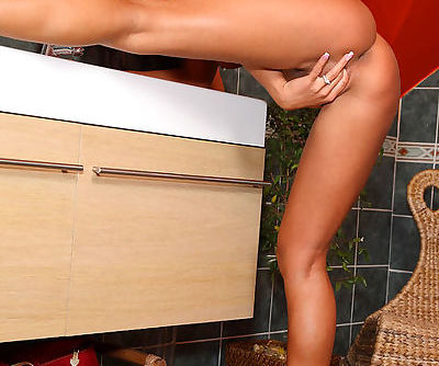 Nataly hangs out in the bathroom and gets all naked for your pleasure
