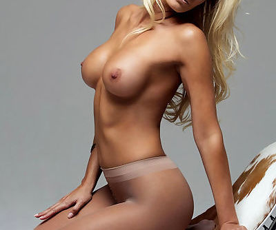 Elegant blonde diva performs sexy posing exposing her perky tits and lascivious pink slit