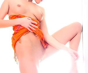 Girl in an orange dress takes it off to show her hot ass and her pussy