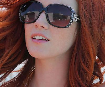 Redhead Elle Alexandra strips from a teeny bikini to show us this hot body