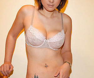 Busty asian babe likes posing when shaving and undulating her gorgeous ass and tits