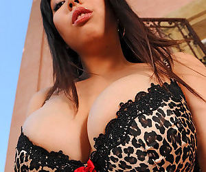 Exquisite Asian stunner in hot black lingerie demonstrates her awesome huge knockers and pierced slit