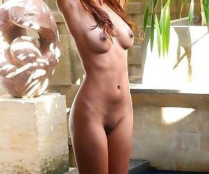 Erotic nude shots of a cute Asian Ellyn as she takes a dip in the pool
