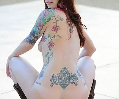 Everything about the outfit is hot on redheaded model Ivy Snow outdoors