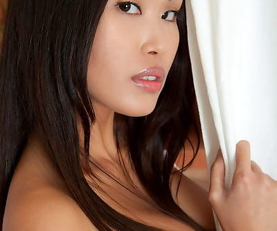 Asian with small perky tits and a smooth body poses naked