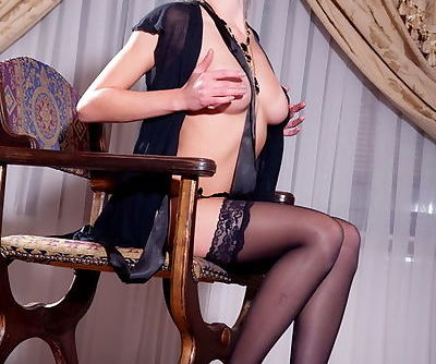 Black stockings with lace tops on the beautiful blonde with hot lips
