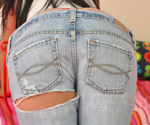 Sweet teen-age queen in a red string shows off her fascinating buttocks