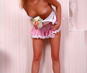Little teeny having fun with flowers, her tits and little pussy