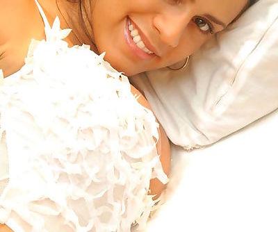 Busty dark haired brunette chick teasing in white lingerie