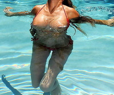 Kayla Carrera takes her tight pornstar body in the pool and strips from her red bikini
