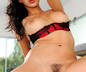Asian pornstar in a sheer black teddy makes sure you see her pussy