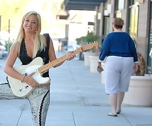 She plays her guitar and shows her fresh shaved pussy