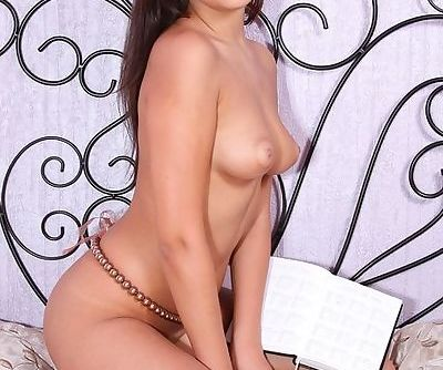 Cutie with big brown eyes and sexy natural tits makes erotic art