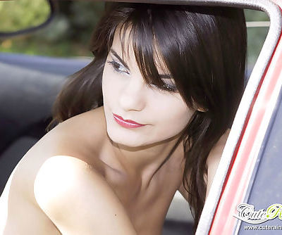 Teen tart poses inside her car with nothing except her tiny thongs on