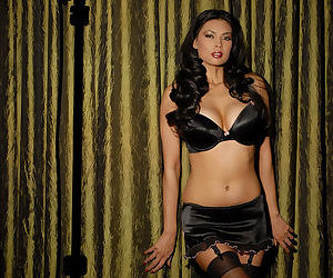 Let the lip gloss wearing Tera Patrick in her satin lingerie stun you