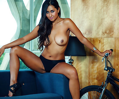 Dark-haired Latina babe looks sexy riding a bicycle, especially if you look from behind