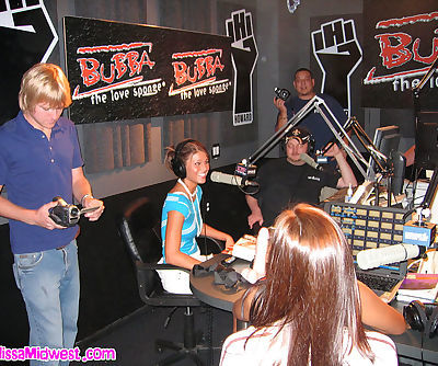Babes have some fun with a strapon dildo on radio
