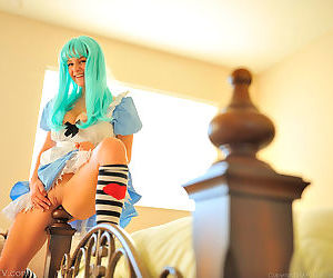 Beautiful freshie in blue wig impales her juicy pussy onto a bed post