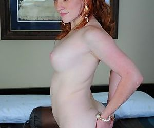 Naughty redhead stuffs her tiny panties into her hungry smooth pussy