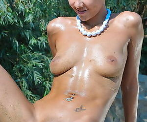 Chick with a tight body and a perfect shaved pussy is wet and sweaty