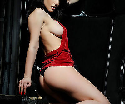 Little red dress is sexy on the glamour girl doing her best to arouse