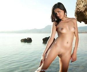 Outdoor poses with the perky beauty and her nice trimmed pussy