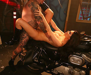 Hot bitch Tera Patrick in shiny boots laid by the man with tattoos