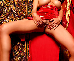 Big red dildo fucks into the sexy pussy of horny hot babe Tera Patrick