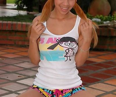 Pig-tailed teen latina with dyed hair shows you her paradisiacal body