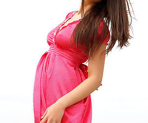 Her pink and white polka dot dress is devastatingly sexy on Asian Kiana